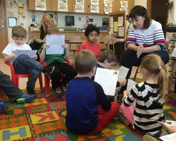 Elementary teacher reads with students