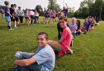 Middle school students play outside