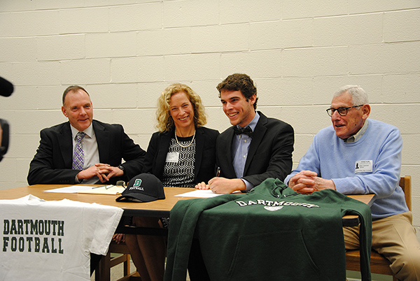 photo of Davis Brief signing a national letter of intent to play football at Dartmouth College.