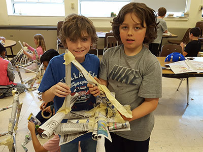 building solid structures from rolled newspaper