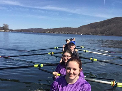WVHS Crew Team members on the water in new boat