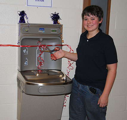 photo of Nick Harris at refillable water stateion