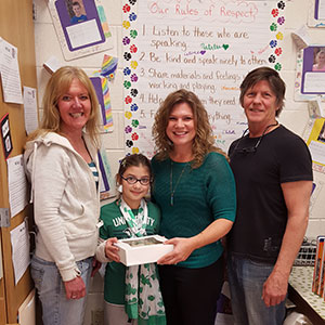 Mrs. Augelli with Noble Pies owners and student