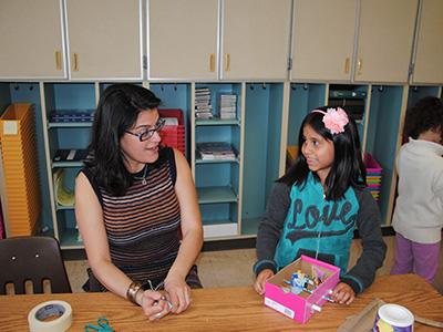 Park Avenue teacher helps student with her upcycling invention.