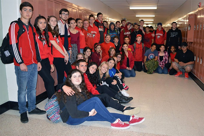 WVHS students dressed in red and black in memory of their classmate
