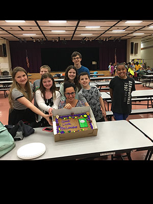 Students present principal with cake