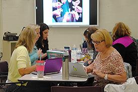 teachers working on laptops