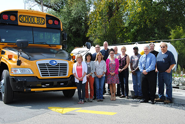 Superintendent Dr. David Leach, Director of Human Resources Mrs. Cindy Leandro, Assistant Superintendent for Business Mr. Timothy Holmes, Director of Transportation Ms. Debra Weissman and members of the Transportation Department stand next to one of the District's new propane buses.