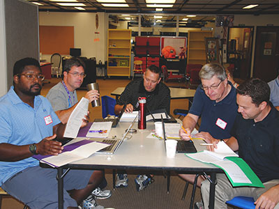 Teachers attend a training on the use of historical artifacts and records in the classroom.