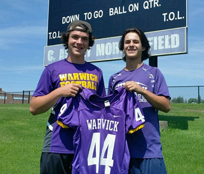 photo of two football players holding the number 44 jersey