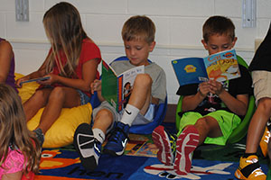 photo of students reading books in the classroom