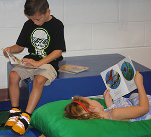 photo of students sitting and lying down while reading