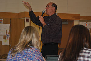 photo of educational consultant G. Lichtman working with teachers.