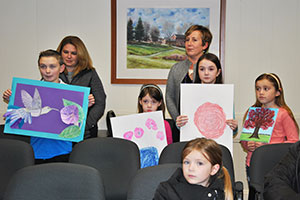 Elem. students with artwork