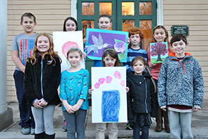 Elem. students with artwork