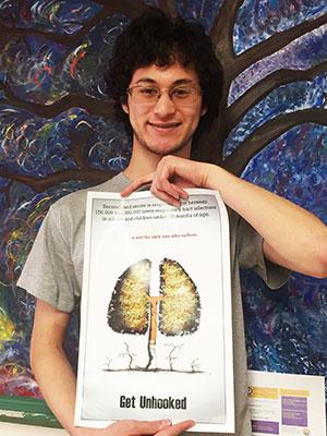 WVHS Senior, Derrek Elgarten, holds his stop smoking poster