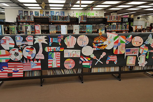 Display of symbols created by students to represent their heritage