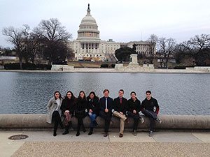 students in front of fountain