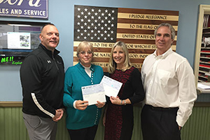 Leo Kaytes Jr. (right), and Leslie Culkin (left), presented Drive 4 UR School donations on behalf of the Ford Motor Company to WVCSD's Gregory Sirico (left) and Heidi Thonus (right).
