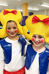 Two members of Shrek's cast pose with their bright -colored costumes.