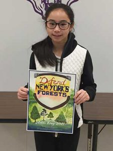 Contest winner poses with her poster.