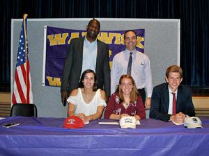 Three student athletes who signed letters of intent pose with Superintendent Dr. Leach and high school principal Dr. Washington