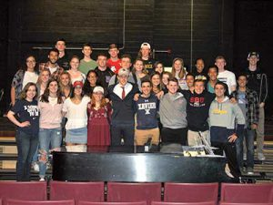 Three student athletes who signed letters of intent pose with teammates