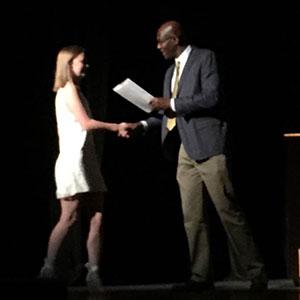 Student accepts award from principal
