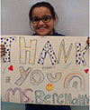 Gabi with Thank You sign