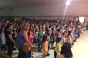 """A view of the school assembly enjoying the """"garden dance"""" performance."""