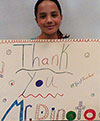 Amanda with a Thank You sign