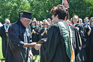 Mr. Rocco Garcia receives WVHS diploma at age 93