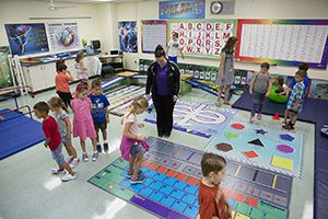 Teachers and kindergarten students work in the Leaning Lab