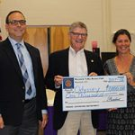 Rotary presents check to support the district's Odyssey of the Mind program