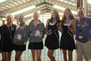 Warwick Valley's girl tennis players and their coaches line up with their awards