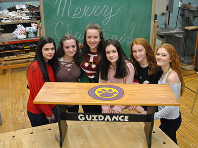 Members of the Middle School's Green Team pose with their bench project.