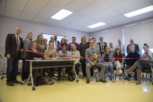 A group photo and the ribbon cutting of the Wildcuts Salon