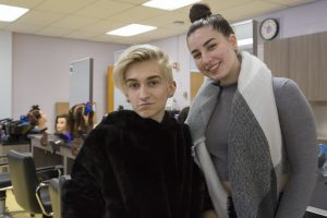 A portrait of two high school juniors who are students of cosmetology