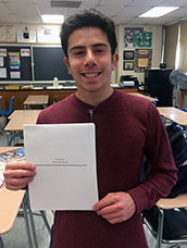 Student holding research paper