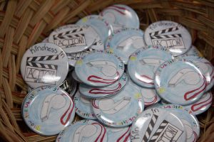 a pile of anti-bullying buttons designed by students