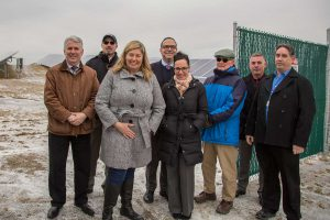 A group photo of district officials at the solar project.