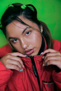 a photo of a teen girl in a red jacket