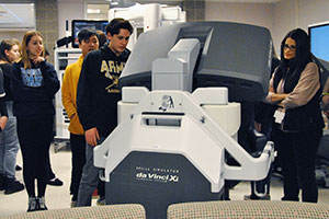 HS students check out a surgical robot