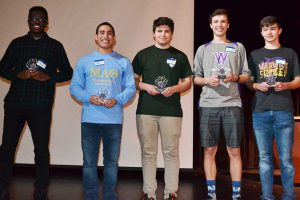 five high school males in a row with trophies