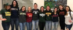 A row of senior girls in college t-shirts