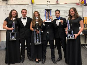 Band students show off their trophees