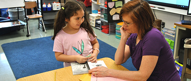 Student reads with teacher