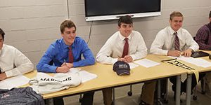 Five Warwick football players sign National Letters of Commitment