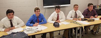 5 WVHS athletes sign letters of intent to play football in college