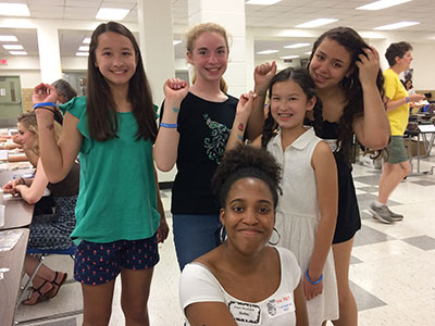 Warwick students show off their temporary tattoos at the Empty Bowls 2018 event